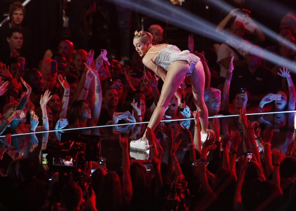 Singer Miley Cyrus performs during the 2013 MTV Video Music Awards in New York in this August 25, 2013 file photograph. Former Disney star Cyrus says she was out to shock and &quotmake history&quot and is unapologetic for her raunchy performance at this year's MTV Video Music Awards. In a documentary, &quotMiley: The Movement,&quot airing on MTV on Oct. 2, the 20-year-old singer and actress comes across as a shrewd, ambitious performer determined to see her single, &quotWe Can't Stop,&quot hit No. 1 and put her roots as the wholesome Disney Channel star of &quotHannah Montana&quot far behind her.