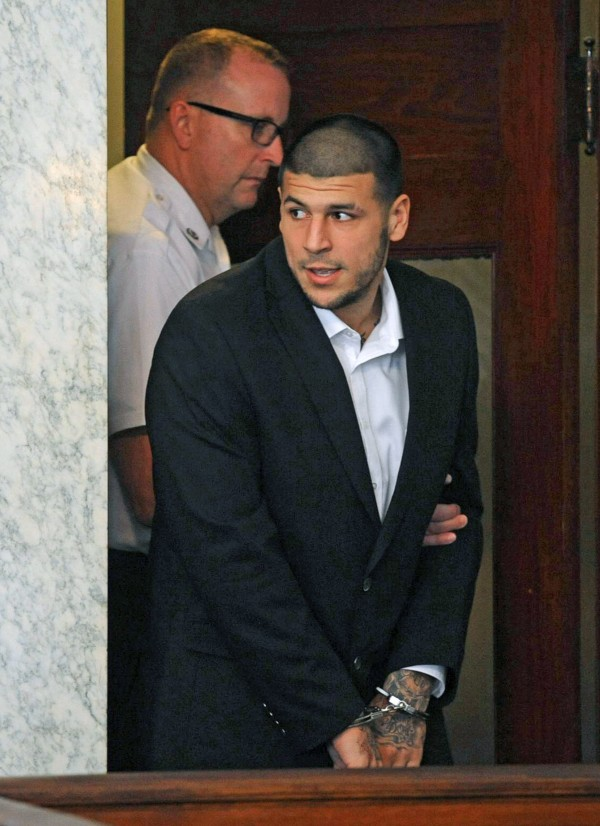 Former New England Patriots tight end Aaron Hernandez is brought into court for a preliminary hearing on murder charges in Attleboro, Massachusetts July 24, 2013.  A probable cause hearing for Hernandez was postponed today at Attleboro District Court.