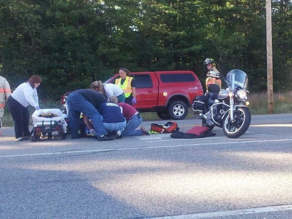 Rescue workers tend to a 44-year old Sanford man after he was thrown off his motorcycle in a collision  in Lebanon on Wednesday.