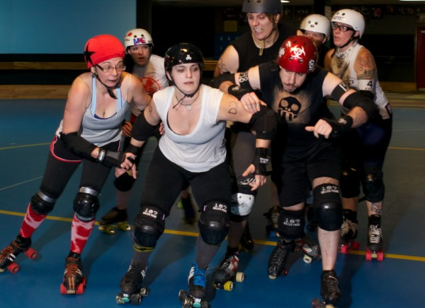 Women roller derby skaters help members of a new men's team get ready for their first bout in Portland Sunday night. From left is Erica Davis, &quotSweet Peacock,&quot Dana Hayes, &quotGrim D. Mise,&quot Jodie Keenan, &quotBrannigan's Law,&quot Chris Ziobrowski, &quotFearUs Oxide,&quot Tony Richards, &quotFoul Plague,&quot Dylan Rohmam, &quotBroseidon&quot and Amy Martin, &quotPunchy O'Guts.&quot The Casco Bay Gentlemen's Derby is set to play the Vermont Mean Mountain Boys October 5 at the Portland Expo.