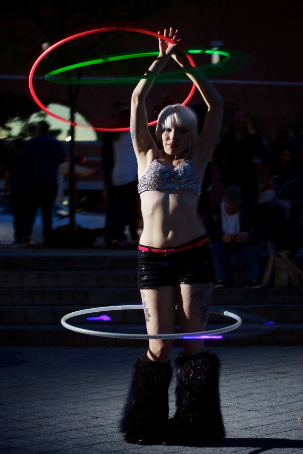 Burlesque performer Alexis Golubow dances in Portland's Congress Square Park Friday night protesting the possible sale of the park to a private developer.