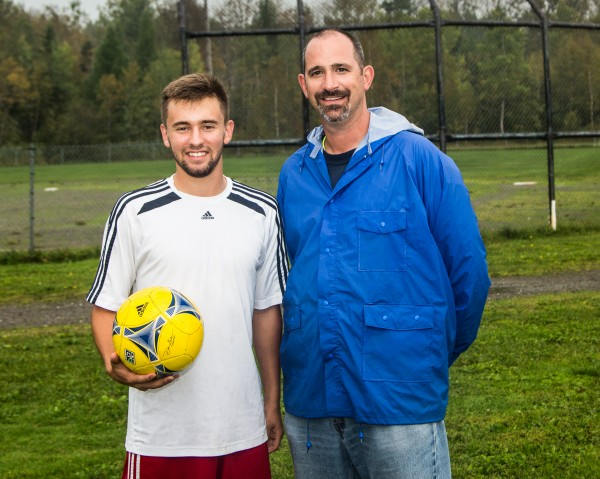 Madawaska High School boys soccer coach Dean Gendreau (right) says  that Ian Lee, the state's new record holder of career goals, has &quotalways been able to score, he's always been able to do whatever he needed to do to score, and he really hasn't changed that way at all.""