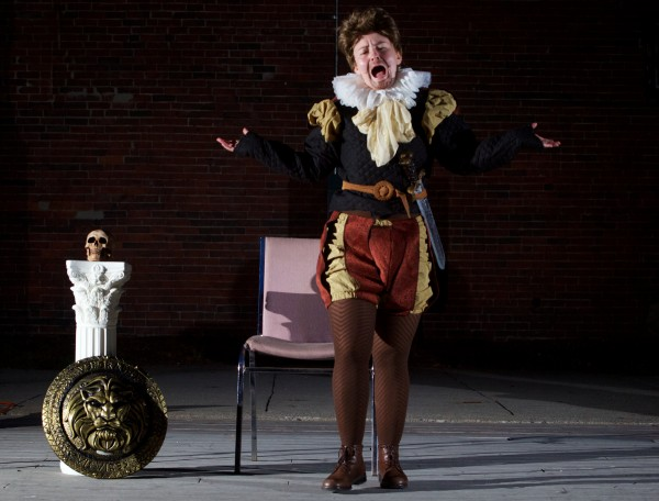 Burlesque performer and school board member Holly Seeliger performs a Hamlet-themed piece in Portland's Congress Square Park Friday night protesting the possible sale of the park to a private developer.