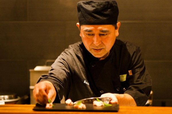 Chef Masa Miyake puts the finishing touches on a plate of sushi recently at his flagship restaurant, Miyake, on Fore Street, Portland. Miyake splits his time between his restaurants in Portland and his farm in Freeport, where he is raising heritage pig breeds to introduce to American palates.