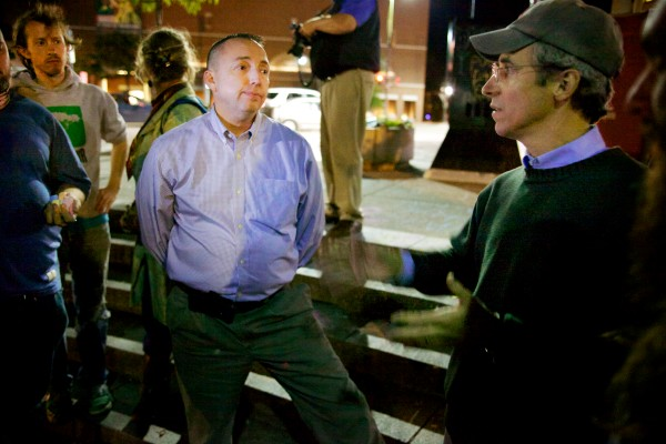 Portland Police Chief Michael Sauschuck listens to unofficial spokesman of the occupiers at Congress Square Park, John Branson, Friday night. The chief asked the protesters to remove their tents and they complied.
