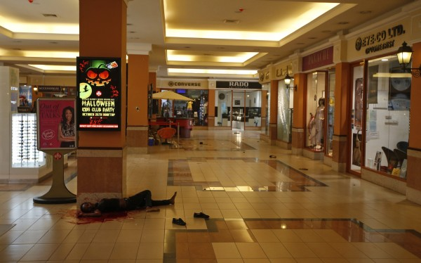 A woman's body is seen in Westgate shopping center in Nairobi after gunmen stormed mall on Saturday.
