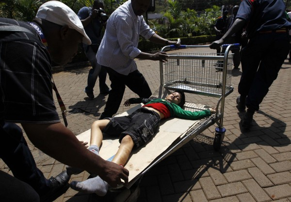 Rescuers use a trolley to push the body of a child killed in a shootout between armed men and the police at the Westgate shopping mall in Nairobi on Saturday.