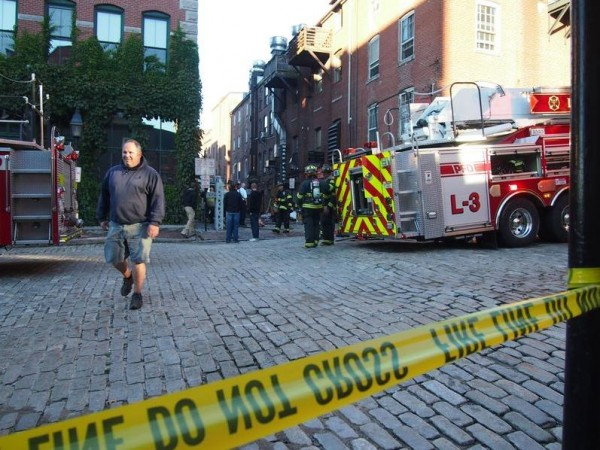 Crews clean up after a three-alarm fire on Wharf Street gutted the basements of several businesses early Thursday, Sept. 19.