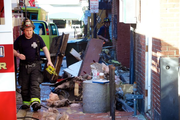Fire crews work at the scene of an overnight fire in a block of buildings on Fore Street in Portland Thursday morning.