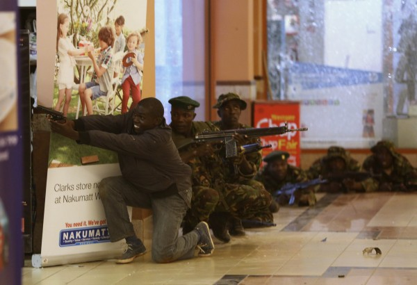 Soldiers and armed police hunt gunmen who went on a shooting spree in Westgate shopping centre in Nairobi on Saturday, Sept. 21.