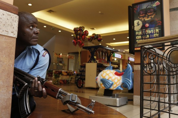 A police officer tries to secure an area inside ta Nairobi shopping center where gunmen went on a shooting spree on Saturday, Sept. 21.