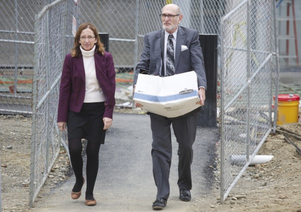 Carole Swan, left, is accused of extorting kickbacks from a contractor who plowed the town's roads. She claims that she was conducting a private sting operation and planned to take evidence of the contractor's wrong doing to prosecutors. Swan leaves the Federal Courthouse in Bangor with her attorney Leonard Sharon in this September 2013 photo. Swan's husband will be tried on five counts of tax fraud on Monday.