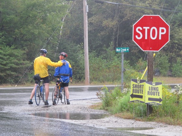 Two bicyclists pause Friday, Sept. 13, at the intersection of Mud Creek Road and Route 1 in Hancock while en route from Bar Harbor to Ellsworth through Eastbrook and Waltham. They were participating in the inaugural BikeMaine 2013 ride, which brought more than 250 experienced bicyclists to Maine for the eight-day tour.