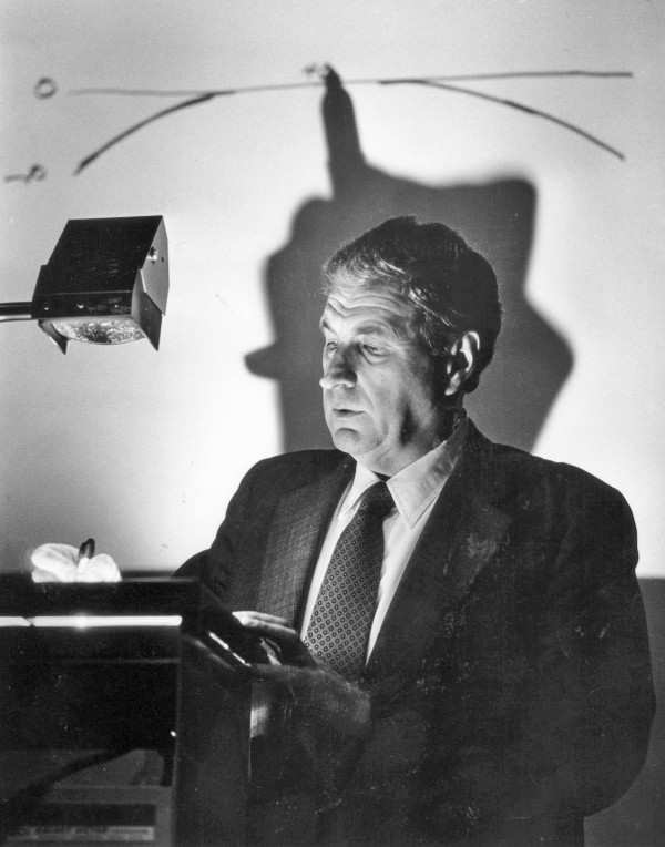 An April 7, 1986, file photo of Ray Dolby as he uses an overhead projector to explain his sound system to executives at the Academy of Motion Pictures in Los Angeles, California. Dolby, who pioneered sound technology in the film and recording industries, died at 80, Dolby Laboratories announced Thursday, September 12, 2013.