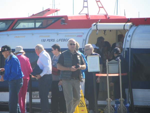 Some of the 650 passengers from the MS Regatta cruise ship come ashore Sunday morning on a shuttle vessel at Rockland's public landing.