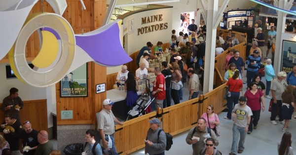 Visitors to the Maine Potato Board booth at the Eastern States Exposition in West Springfield, Mass., make their way through the crowds after purchasing a Maine baked potato during one of the past year's events.