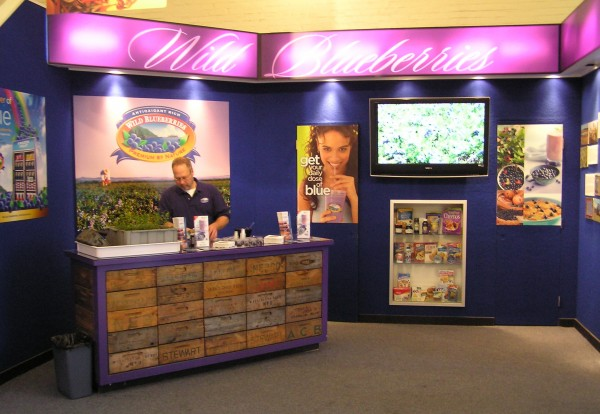 The Wild Blueberry Commission of Maine prepares its booth at the Eastern States Exposition in West Springfield, Mass.
