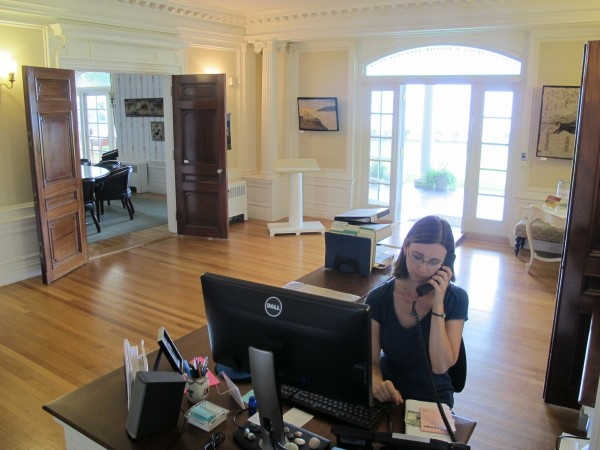 Tina King, development assistant for Maine Sea Coast Mission, uses the phone Wednesday, Aug. 28, 2013, at a desk in the main hall of the mission's headquarters, the La Rochelle mansion on West Street in Bar Harbor. The former mansion was donated by Tristram Colket to Maine Sea Coast Mission in 1972, as was a dedicated endowment for the building's upkeep.