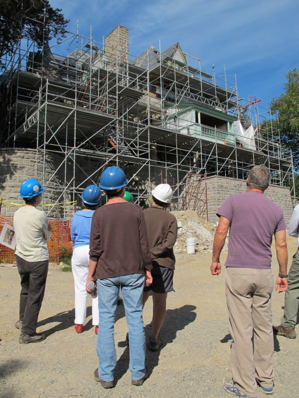 A group of people look the Turrets administration building at College of the Atlantic on Friday, Aug. 16, 2013, just prior to climbing the scaffolding for a closer view. The former Bar Harbor mansion, built in 1895, is undergoing a $3.4 million renovation.