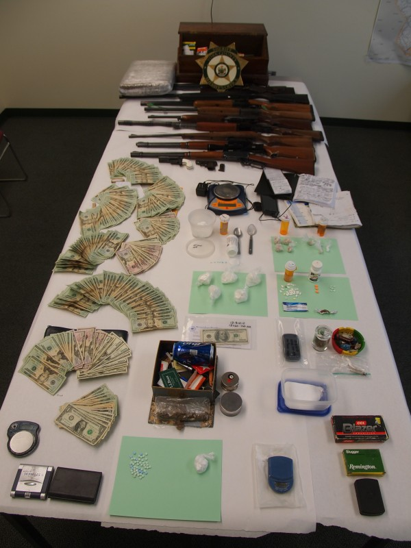 Drugs, guns and cash were seized Wednesday as police arrested three men in connection with a Kennebunk drug ring.