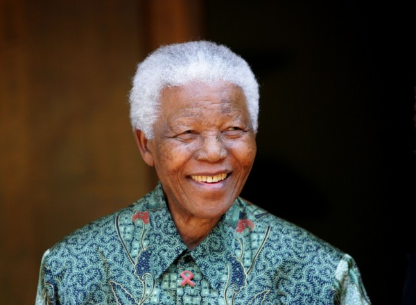 Former South African President Nelson Mandela greets photographers in Johannesburg in this September 22, 2005 file photo. Anti-apartheid leader Mandela was discharged from hospital and returned home on September 1, 2013 after being treated for a recurring lung infection, the government said in a statement.