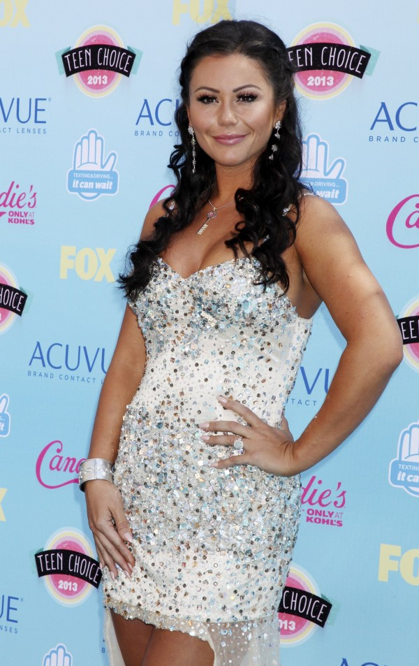 Television personality Jenni &quotJWoww&quot Farley poses as she arrives at the Teen Choice Awards at the Gibson amphitheatre in Universal City, California August 11, 2013.