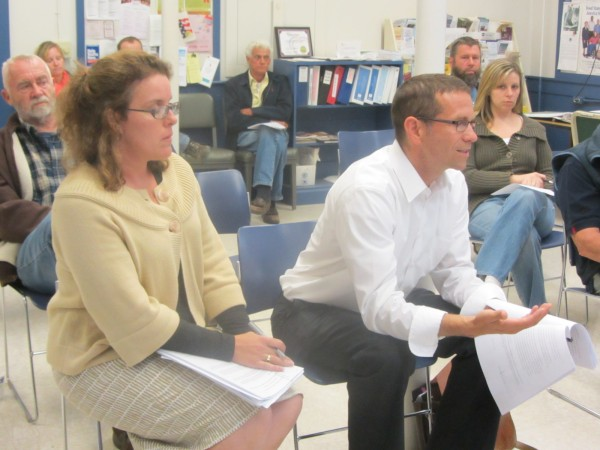Attorney Patrick Mellor (right) speaks before the Appleton Board of Appeals on Tuesday night. Resident Lorie Costigan (left) is one of four neighbors seeking to overturn a variance granted after the fact for the construction of a house.