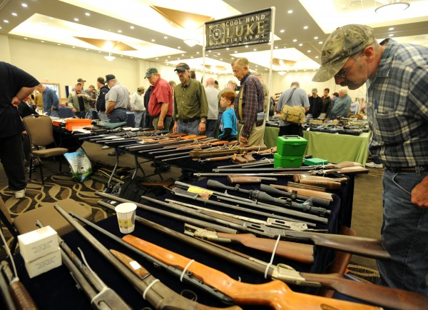 Gun enthusiasts peruse the inventory at the 2013 Annual Bangor Gun Show at the Cross Insurance Center Saturday morning.  The weekend event is hosted by the Penobscot County Conservation Association.