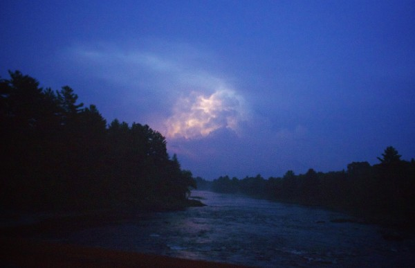Lightning strikes brighten the sky over the Eastern Branch of the Penobscot River Wednesday evening in northern Penobscot County after a storm left thousands without power throughout Maine.