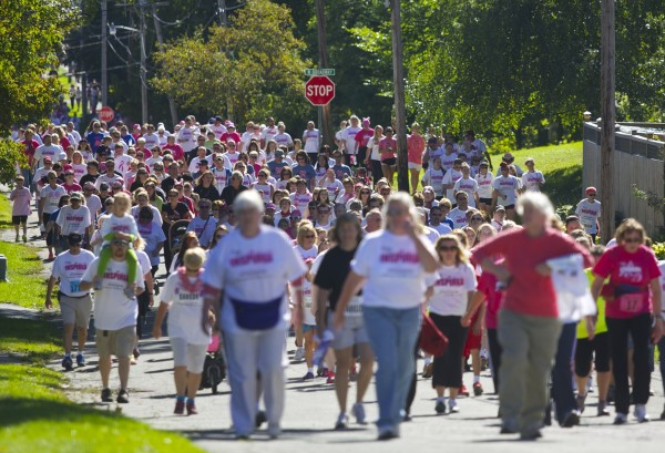 Thousands walk and run up Lincoln Street in Bangor during the 2013 Susan G. Komen Race for the Cure Sunday morning in Bangor.