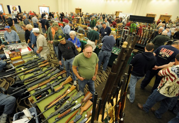 Gun enthusiasts peruse the inventory at the 2013 Annual Bangor Gun Show at the Cross Insurance Center Saturday morning.