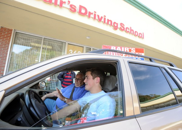 Jacob Neal, 17, of Brewer listens to instruction from Jim Bair as he prepares for his first hour of driving Friday.