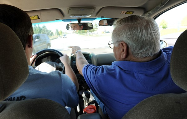 Jim Bair (left), owner of Bair's Driving School in Bangor, instructs student Jacob Neal, 17, of Brewer to make a left turn during Jacob's first driving class. Several new regulations will take effect on Oct. 9, 2013, including increasing the amount of hours a Learner's Permit holder must drive while accompanied by a parent or guardian from 35 hours to 70 hours.