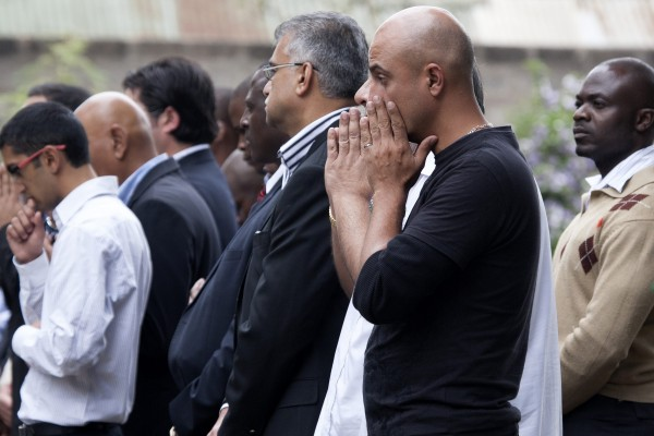 People attend the funeral of Selima Merali, 41, and her daughter Nuriana Merali, 15, who were killed in the attack by gunmen at the Westgate Shopping Centre in Nairobi, September 25, 2013. As Kenya began three days of mourning on Wednesday for at least 67 people killed in the siege of a Nairobi mall, it was unclear how many more hostages may have died with the Somali Islamist attackers buried in the rubble.