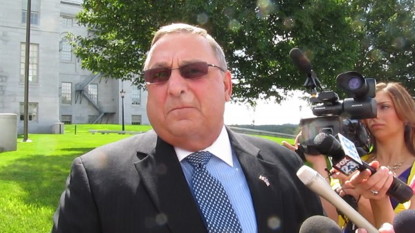 Gov. Paul LePage speaks with reporters on Wednesday, Aug. 14, 2013, outside the State House.