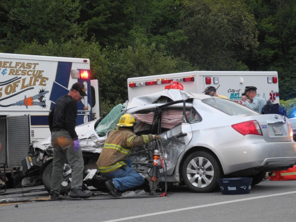 Rescue personnel work Saturday evening to free a driver who was trapped in her car after an accident near the Route 1 Jug Handle in Belfast. The driver was taken to Eastern Maine Medical Center in Bangor by Life Flight helicopter after she was cut out of the car.