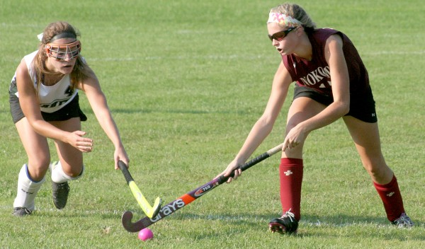 Sadie Royer of Leavitt (left) and Olivia Brown of Nokomis battle for the ball during their high school field hockey game in Turner on Wednesday. The Warriors won 4-1.