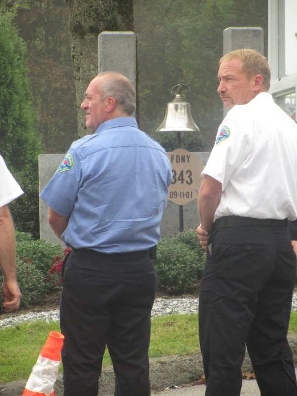 Dennis Camber (left) and Assistant Chief Kenneth Elwell of the Rockland Fire Department stand in front of the 9/11 memorial outside the fire station in Rockland. Rockland held a ceremony Wednesday on the anniversary of the 2001 terrorist attacks.