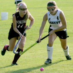 Mikayla Pelkey of Nokomis (left) and Sadie Royer of Leavitt chase down the the ball during their field hockey game in Turner on Wednesday. Nokomis won 4-1.