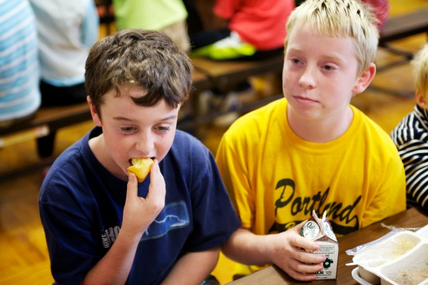 Nick McGonagle, 10, (left) and Clayton Meyer, 10, talk about their school lunches at Portland's Longfellow Elementary School Thursday. The Hunger-Free Kids Act limits calories and salt, adds more whole grains and requires daily servings of fruits and vegetables in school lunches.