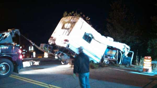 A tow truck hauls a 1992 Ford Motorhome from down an embankment after the recreational vehicle crashed through a guardrail on Route 2 after exiting I-95 for a construction detour in Island Falls. The driver and two passengers, all of Nova Scotia, Canada, were transported to Houlton Regional Hospital to be treated for unspecified injuries. The crash remains under investigation.