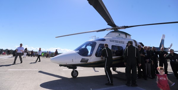 Visitors and crew look at one of the helicopters used by LifeFlight of Maine at the Eastern Maine Medical Center helipad on Sept. 28, 2013.