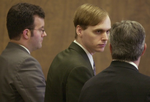 Roscoe Sargent consults with his defense attorneys Joseph Pickering (left) and Christopher Largay (right) after being sentenced  at Penobscot County Superior Court in 2004.
