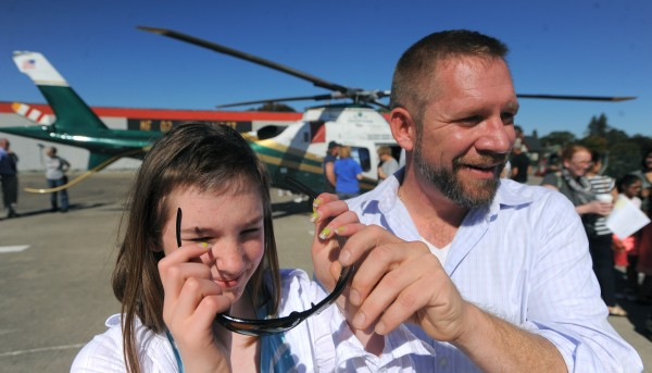 Abigail Martin (left) borrows sunglasses from her father, Jeremy Martin, as they talk about their experience with LifeFlight of Maine.  Abigail was injured while skiing in March and she had to be flown to Eastern Maine Medical Center for treatment of head injuries. LifeFlight of Maine is celebrating its15th year in service.