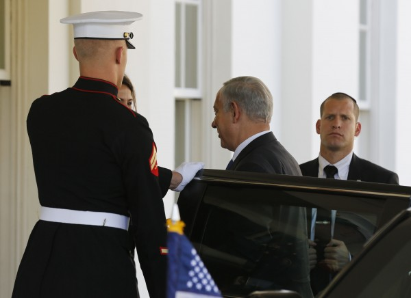 Israeli Prime Minister Benjamin Netanyahu (C) arrives at the White House before meeting with U.S. President Barack Obama in the Oval Office, September 30, 2013.