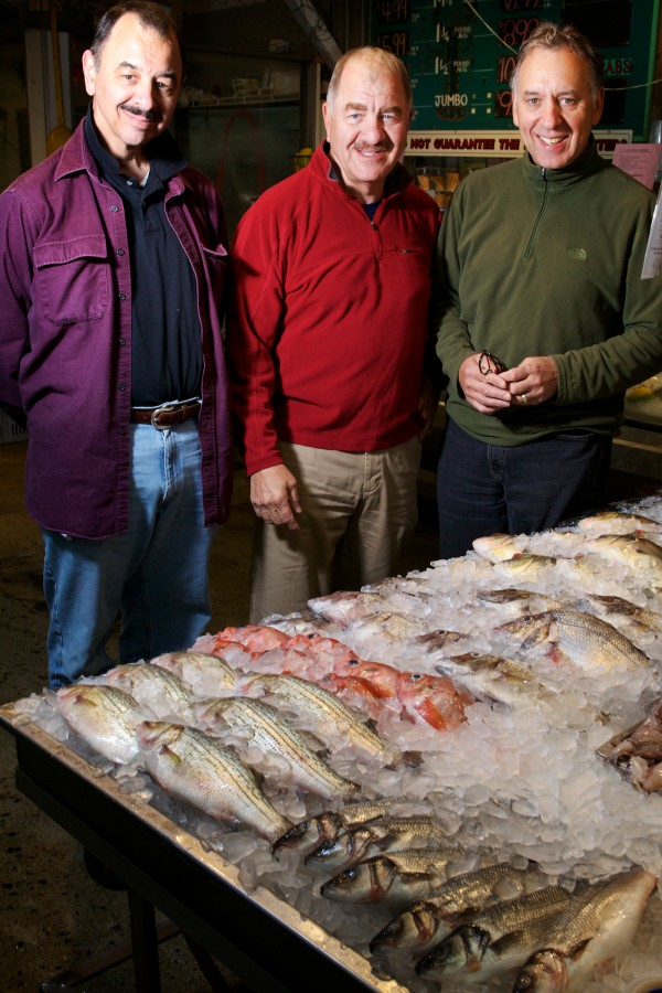 The Alfiero brothers (from left) Ben, Nick and Mike, have operated Harbor Fish Market on Custom House Wharf in Portland since 1964.