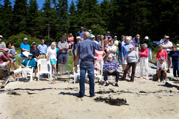 In this August 15, 2013 file photo, Bud Brown of Eco-Analysts Inc. talks to a crowd of people about a proposed dredging project in Southport. Jessamine Logan, spokeswoman for the Maine Department of Environmental Protection, said September 12, 2013, that the department was notified via email that the project will not move forward.