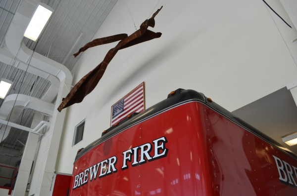 A piece of steel from one of the World Trade Center towers attacked on Sept. 11, 2001 hangs in the Brewer Fire Department's truck bay at the Brewer Public Safety building on Wednesday.