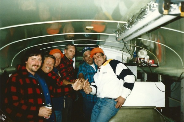 Tony Reynolds (from left), Wayne Therrien, Alfred Porter, Verle Drinkwater, Steve Foster and Charles Veysey celebrate another day in a reconditioned bus that they used as a hunting camp in the 1990s.