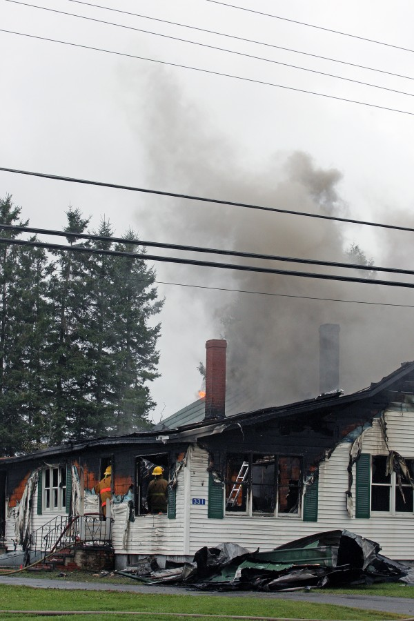 Firefighters from Oakfield, Houlton and Sherman were on the scene of an early morning fire at 331 Oakfield-Smyrna Road in Oakfield Monday morning. The fire was connected to a suspected shooting, the deaths of two people and three separate fires in Oakfield and Island Falls. Police are looking for 32-year-old Matthew Davis of Houlton, who they have identified as the prime suspect and who is considered armed and dangerous.